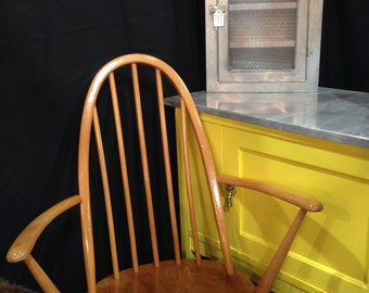 A pair of 1960's Ercol Windsor Carver chairs