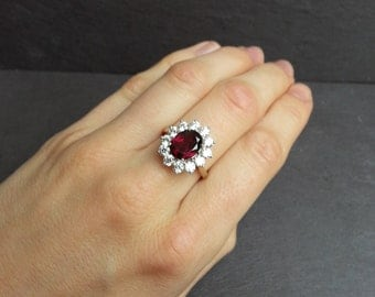 Garnet Engagement Ring, in Yellow Gold With Diamond Halo