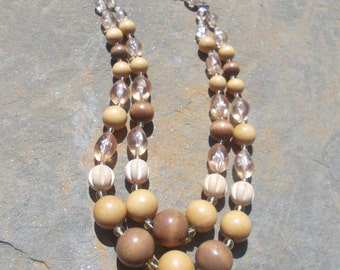 1960's 2 strand graduated wooden and plastic bead necklace in caramel shades.
