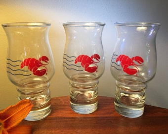 Three vintage Red Lobster hurricane glasses with rare blue wavy lines by Libbey