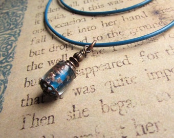 Copper and lampwork charm on leather cord