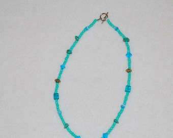 Blue beaded necklace with moonstone center