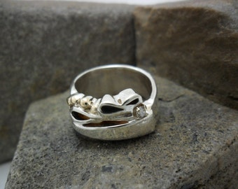 Decorated with beads of yellow gold and diamond sterling silver ring