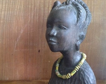 Nice African statuette made of heavy wood.