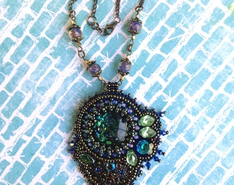 Green/blue bead-embroidered pendant