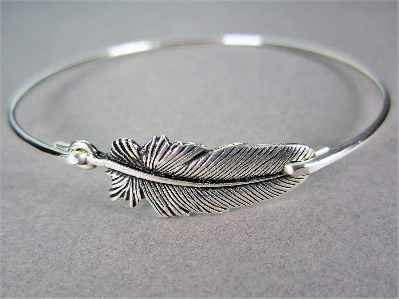 silver feather bangle bracelet feather bracelet by baublevine