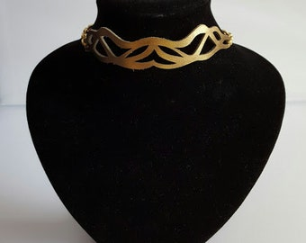 Choker made from laser cut bronze leather