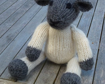 Knitting Pattern (UK) for Lucy Lamb - a cute black-face knitted lamb.  Worked in a simple stocking stitch with a plaited tail..