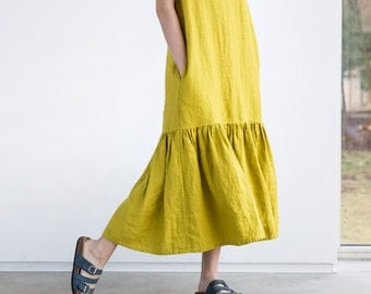 Drop ruffle maxi linen dress. Washed and soft linen dress in greenish mustard
