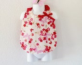 Large bib for baby / little girl printed with asian / japanese patterns: cherry blossoms, butterflies
