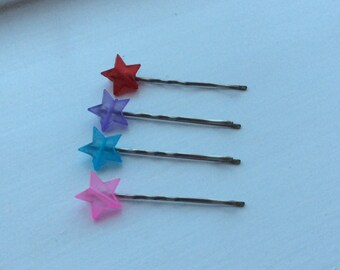 Set of four transparent star bead bobby pins on coordinating chrome kirby grips