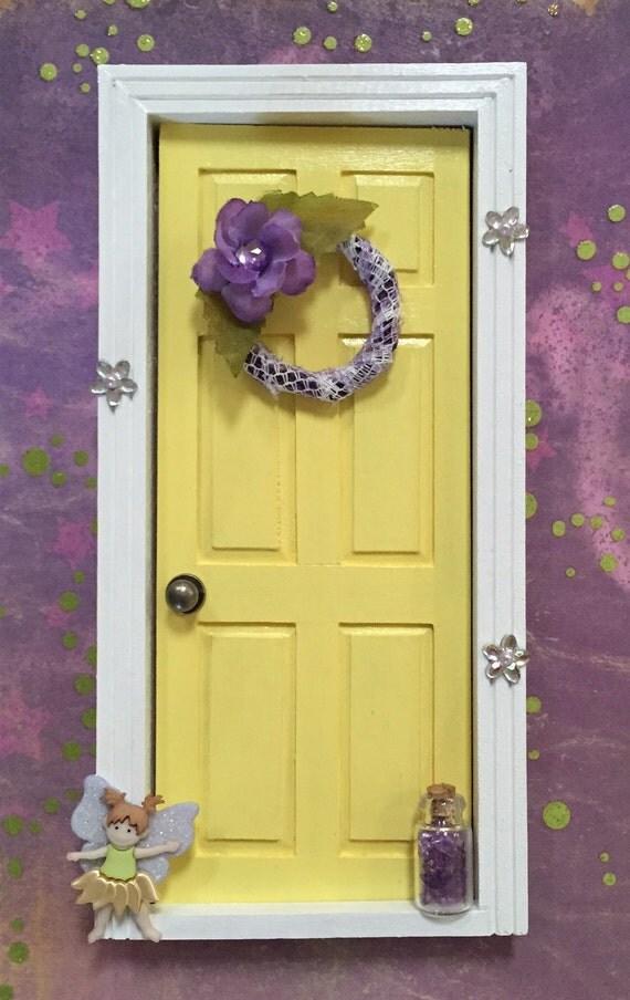 Yellow fairy door for White fairy door
