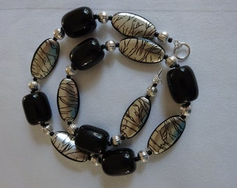 Black and silver metallic beaded necklace w/ earrings