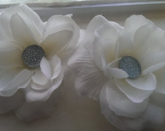 Two white flower hair clips