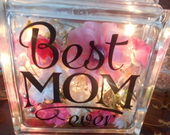"glass block with lights ""Best Mom Ever"" on front"