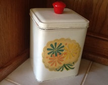Canisters from 1950's. Pale yellow with red Bakelite or plastic knob