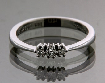 Modern Engagement ring Trystars trilogy, white gold and brilliants