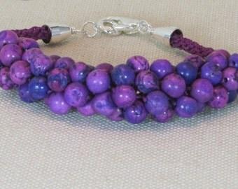 Kumihimo purple beaded bracelet
