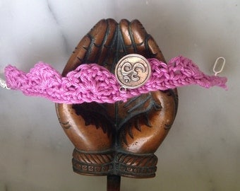 Crocheted bracelet with OM