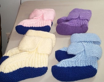 Slippers, bootie style, in contrasting color with padded foot to keep your tootsies warm.  Machine wash hand dry.