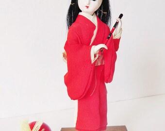 Vintage Japanese flute player doll