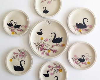 Super festive set of one very large Black swans and blossoms serving plate and six smaller (cake) plates
