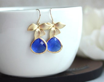 A Matte Gold Plated Orchid Flower Cobalt Blue Glass Framed Jewel French Drop Earrings. Bridesmaid Gifts. Modern Flower Jewelry