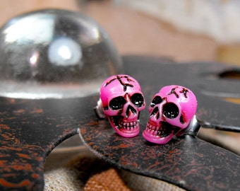 Tiny skull studs in pink. Unisex earrings. Surgical steel