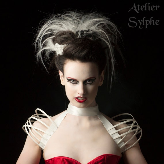 White neck collar and fantasy shoulders boned crinoline cage.