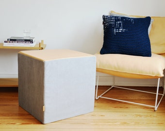 seat cube made of gray twill and vegetable dyed leather