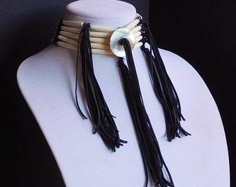Five Strand Bone Hair Pipe Choker with Black Deerskin Fringe and Tassel and Abalone Shell Center Disk with Hemalyke Drum Beads
