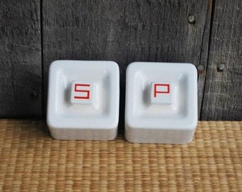 vintage stove-top salt and pepper shakers - porcelain - white with red lettering
