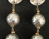 over the top silver and gold pizazz clip on earrings