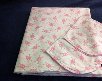 Pink Skulls with Pink Animal Print Backing Hemstitched Baby Blanket and Burps ready for you to crochet by Lindas Hemstitching