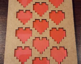 Pixelated heart tokens (13)