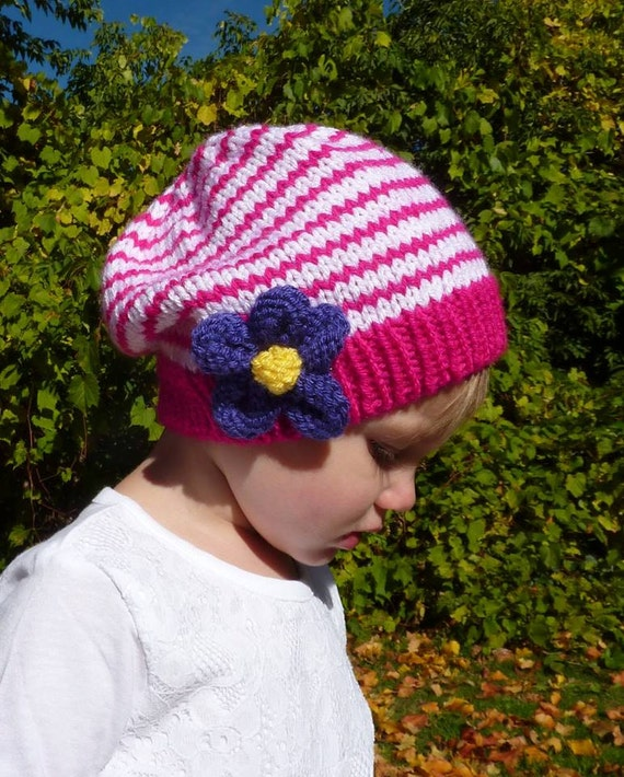 Knitting Pattern For Beanie With Flower : PATTERN 109: Childrens knit beanie with purple knit flower