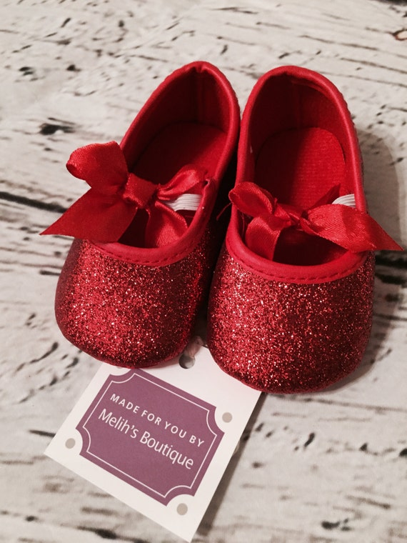 These red sparkle glitter Tom's are so cute! Perfect for a Dorothy costume. Great for a baby girl. Size is 2. They have a velcro closure. They are in great condition, with only a little glitter missin.