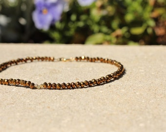 Bronze beaded choker with little gold beads