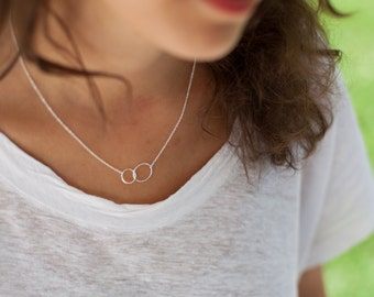 Two Entwined Tiny Circles necklace in Sterling Silver