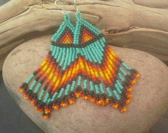 Native American inspired dangly earrings in turquoise and red