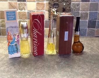 Three Avon 70's cologne bottles