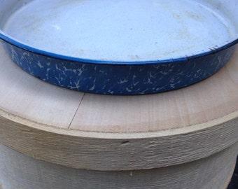 Old blue splatterware enamel cake pan