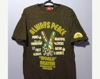 20% HOT SUMMER SALE Vintage 90s save the world by kriff mayer always peace tee shirt