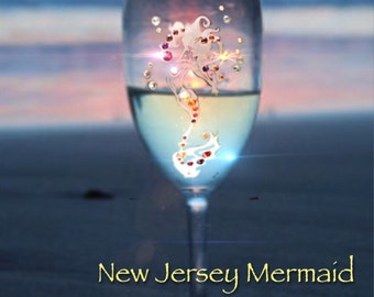 Swarovski cystalized; engraved Mermaid Wine glass.  Hand etched and available in Red or White wine glasses.