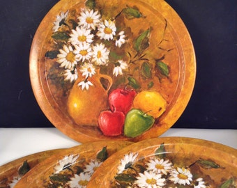 Vintage metal serving trays with apples and daisies