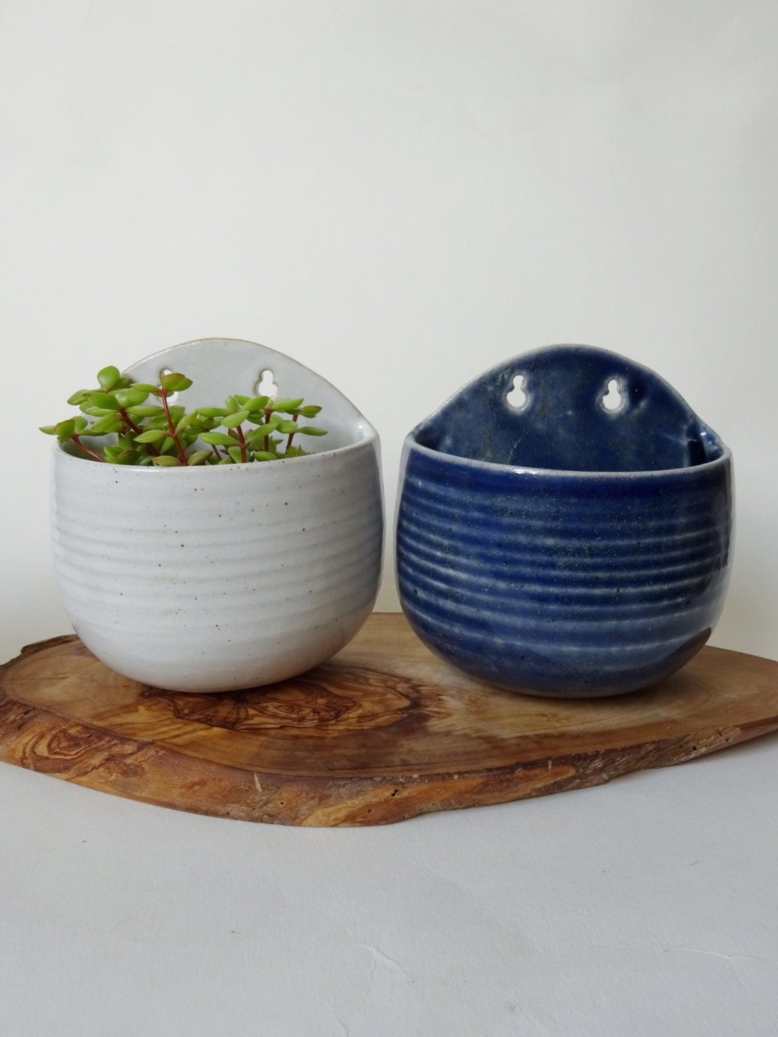 Set Of Two Small Handmade Ceramic Wall Planters Creamy