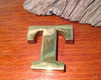 Brass paperweight letter T