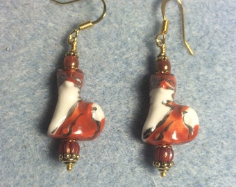 Orange red and white ceramic fox bead earrings adorned with orange red Czech glass beads.