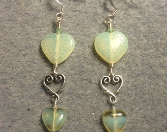 Large and small matching light yellow Czech glass heart bead earrings joined by a silver Tierracast heart connector charm.