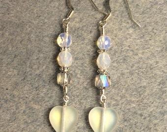 Matte clear Czech glass heart bead dangle earrings adorned with clear Czech glass beads.
